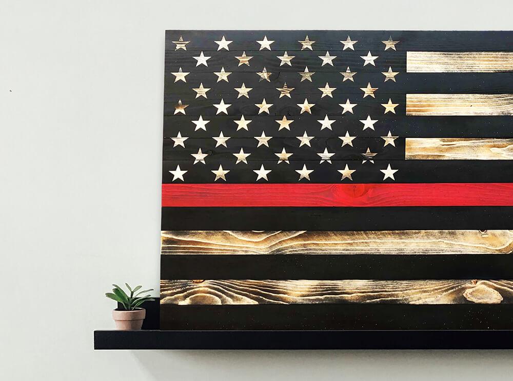 Thin red line american flag on black shelf-webready-compressed